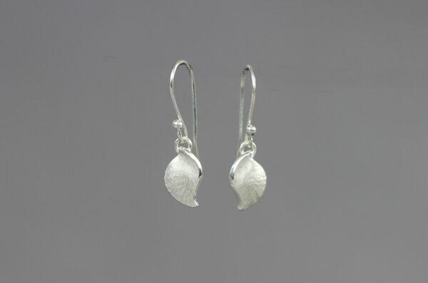 Conch drop earrings by Rauni Higson